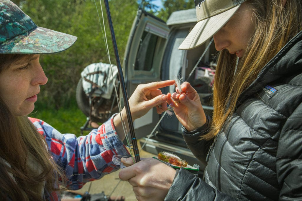 Examining a fly for a fishing trip in Oregon