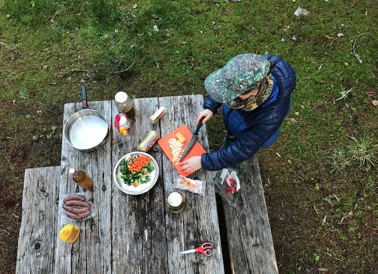 Dinner prepared by the campfire