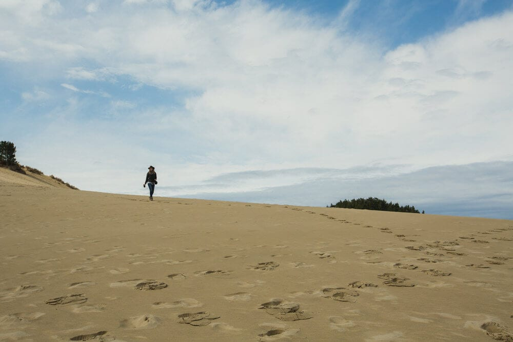 Trekking on the sand dunes in Oregon