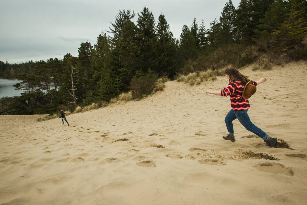 Running down the sand dunes in Oregon