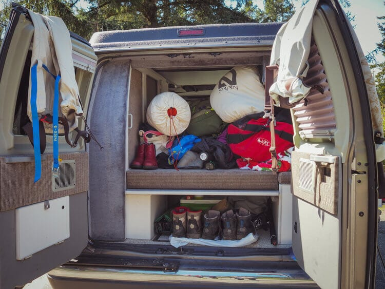 Gear packed into a ROAMERICA campervan