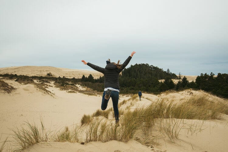 Roving Dears leap for joy on the sand dunes in Oregon