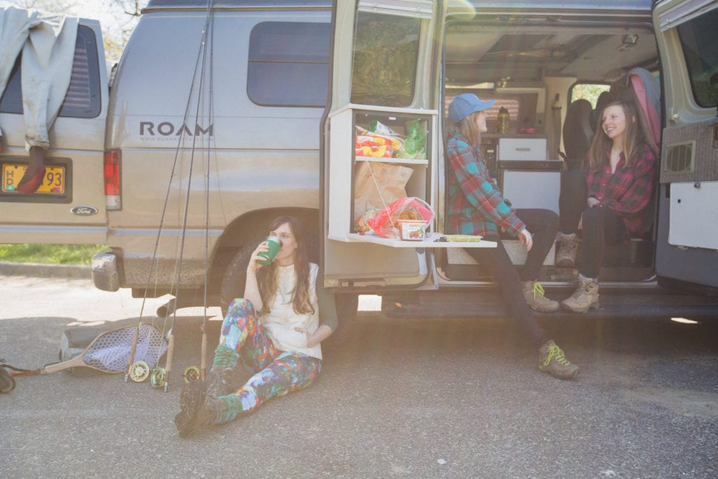 Roving Dears relaxing in their ROAMERICA campervan