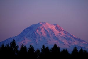 Snow-covered Mount Rainier at sunset