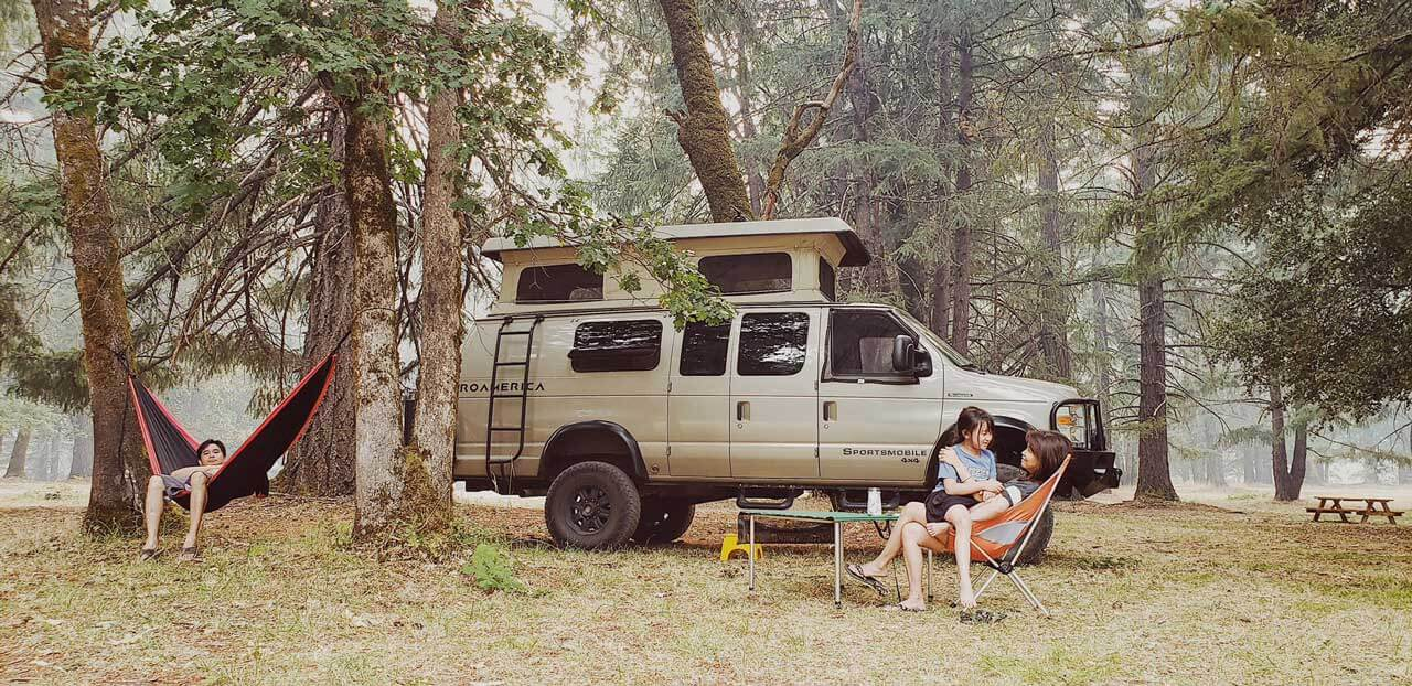 Family camping in Oregon out of a van