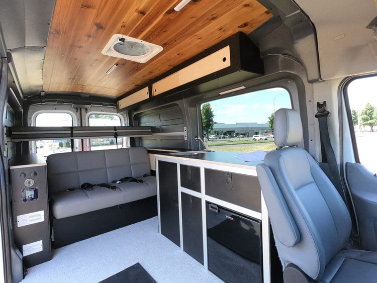 Inside the new Ford Transit Campervan conversion with full kitchen and sofa bed