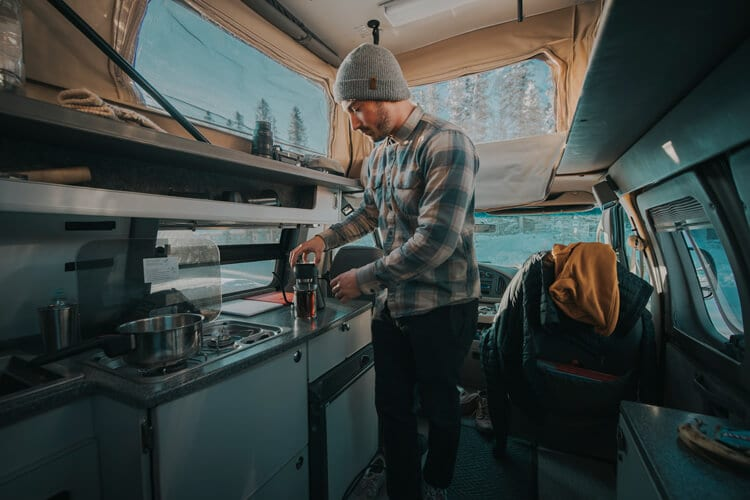 Making coffee in adventure van