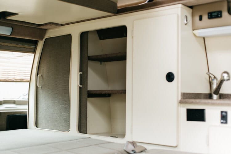 Storage for gear and clothes in adventure van