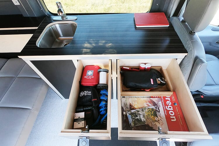 camp equipment organized in a camper van