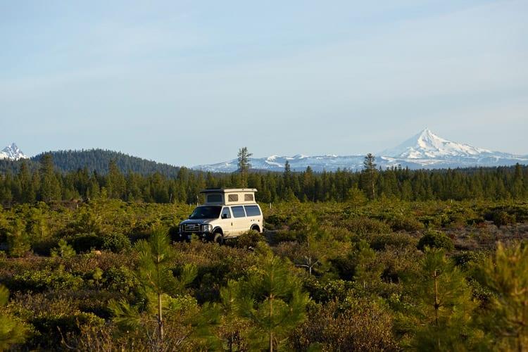tiny home vs van living in a 4x4 4wd Ford Econoline Sportsmobile campervan