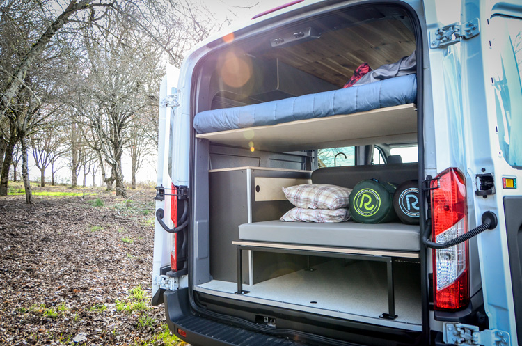 Rear view of converted Ford Transit campervan in Oregon with 2 beds and kitchen