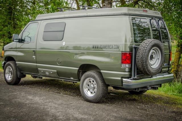 Passenger rear side of 2wd Ford Econolibe Sportsmobile for sale in Portland, Oregon through Roamerica camper van rental company