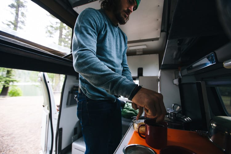 Making coffee in a van while road tripping through Oregon