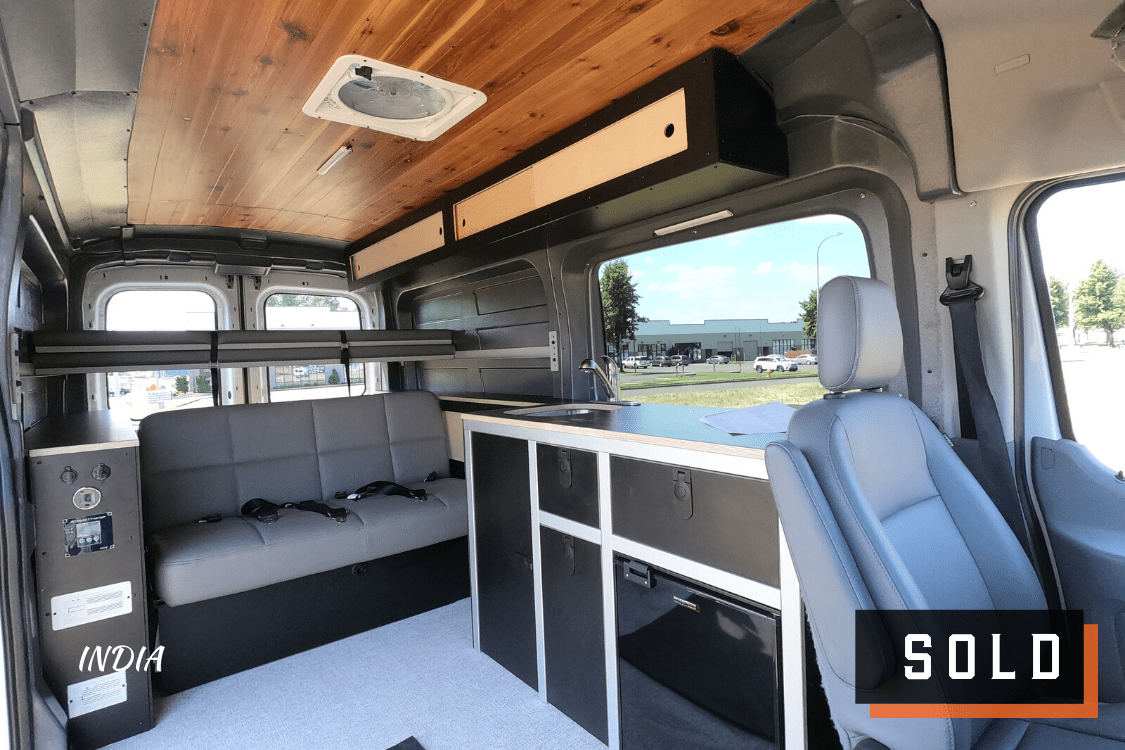 Look inside of Ford Transit Campervan for sale built by Axis Vehicle Outfitters in Portland, Oregon