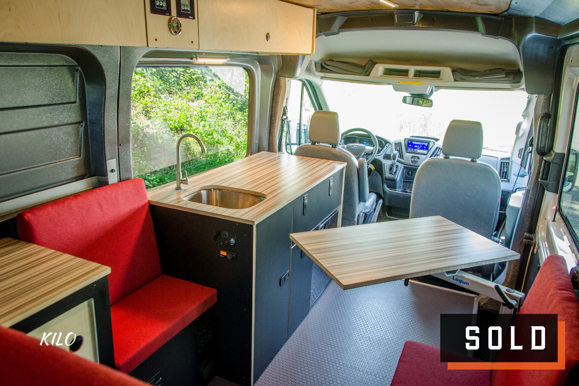 Look inside of 4x4 Ford Transit Campervan for sale built by Axis Vehicle Outfitters in Portland, Oregon