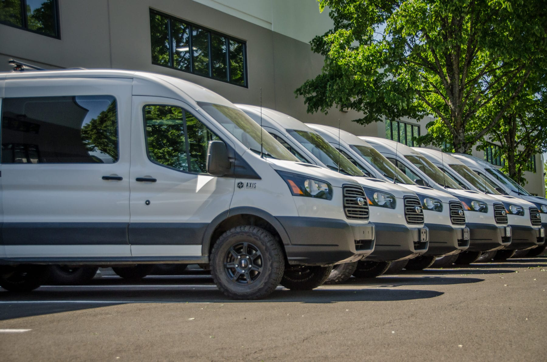 The Axis Vehicle Outfitter's fleet includes 4wd Ford Econolines and 2wd Ford Transits and 4wd Ford Transit camper vans for rent and for sale