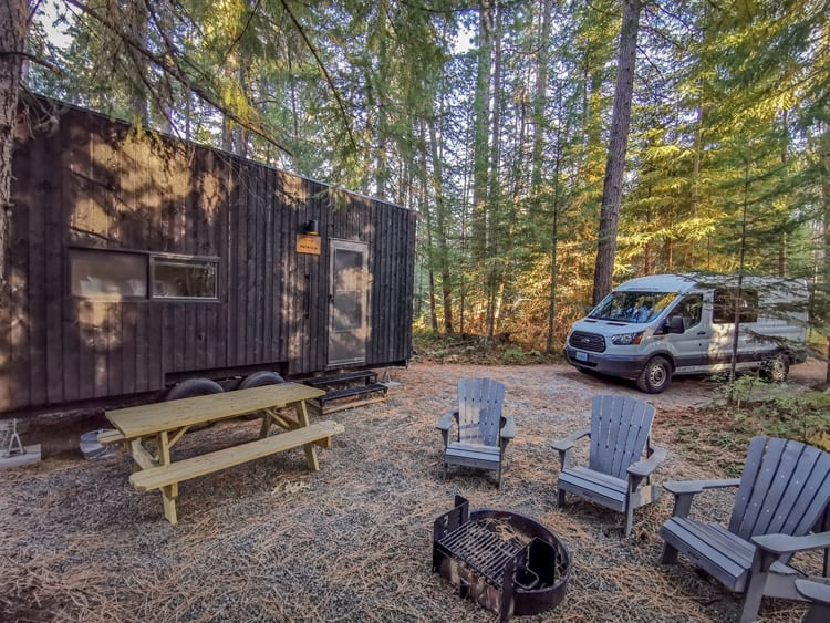 A luxury of van life, staying at a cabin in the woods half way through your trip