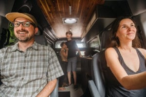 Family of four inside the Roamerica campervan rental on an Oregon road trip