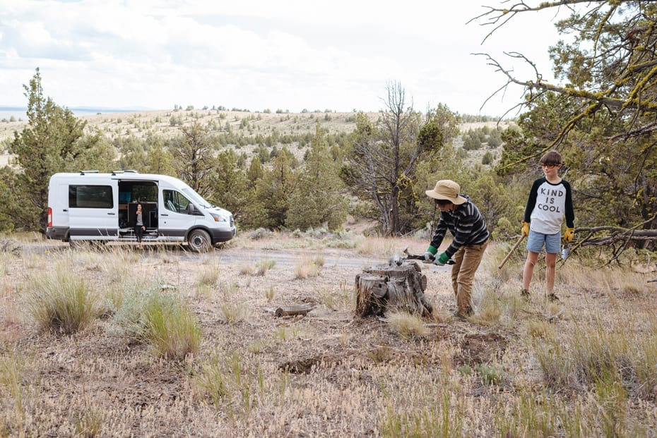 Roamerica converted campervan Ford Transit in Oregon High Desert road trip and chopping wood