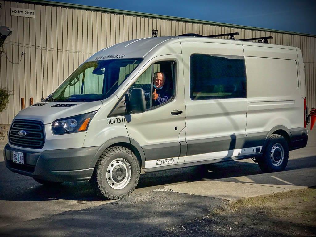 Thumbs up! Ford camper van rental is off to adventure.