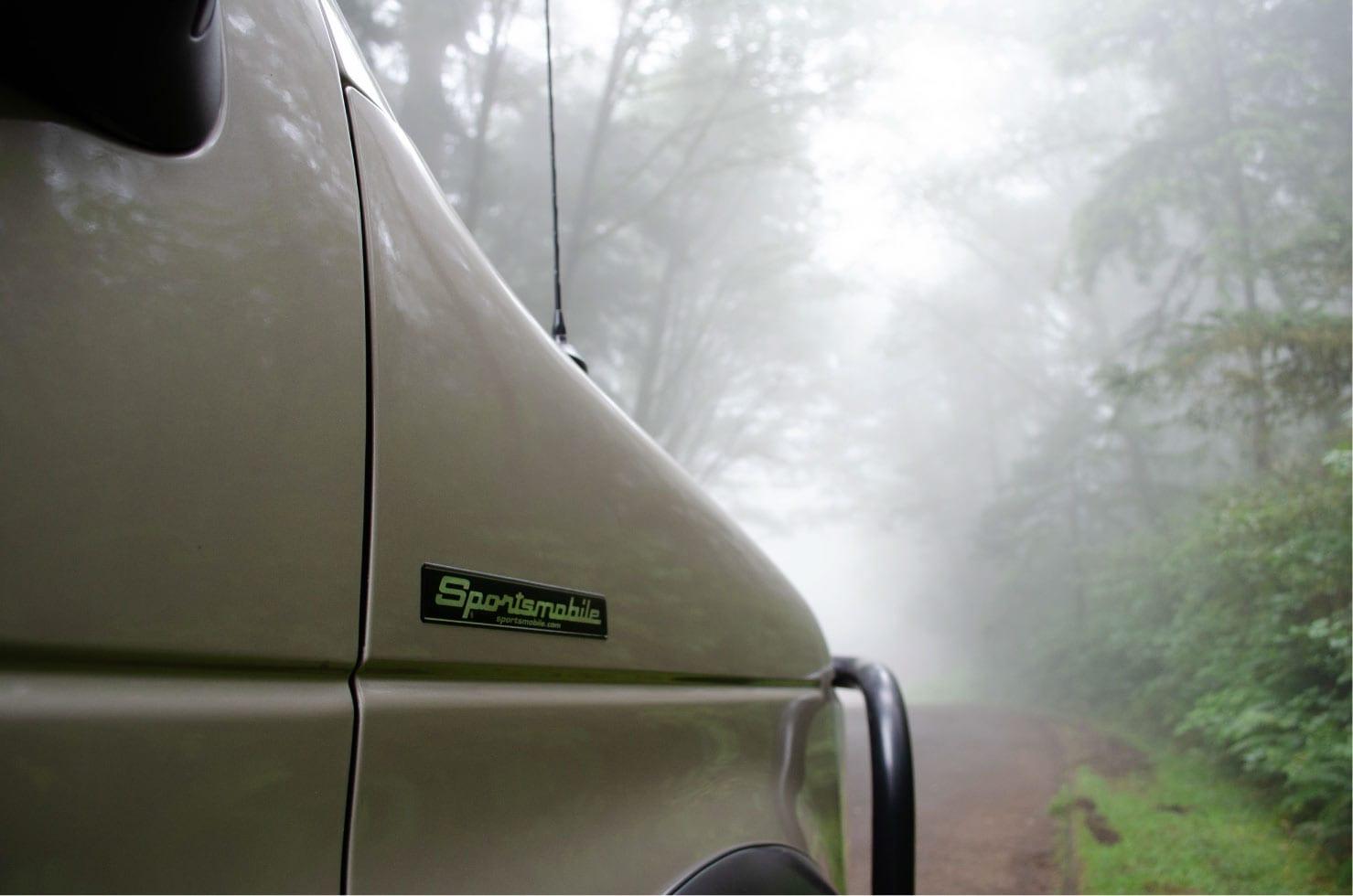 Sportsmobile logo on a Ford E-Series 4x4 Econoline Sportsmobile EB50 Layout Campervan conversion for sale