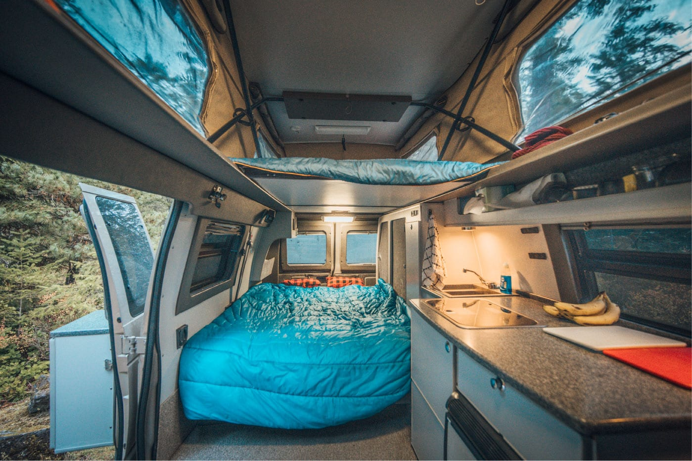 2 beds in a Ford E-Series 4x4 Econoline Sportsmobile EB50 Layout Campervan conversion for sale