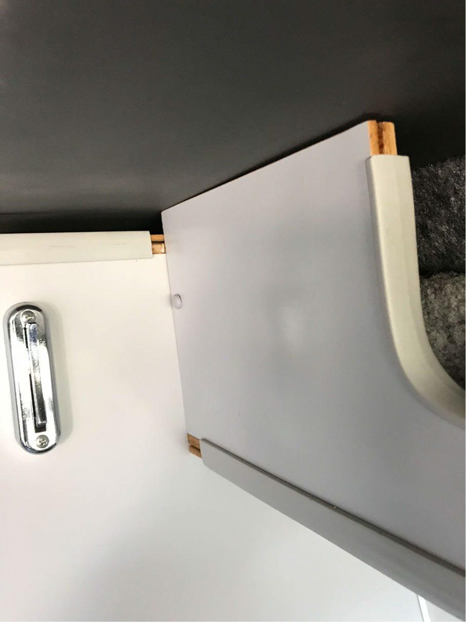 Upper kitchen cabinet with vinyl trim on a 2008 Ford Econoline Sportsmobile