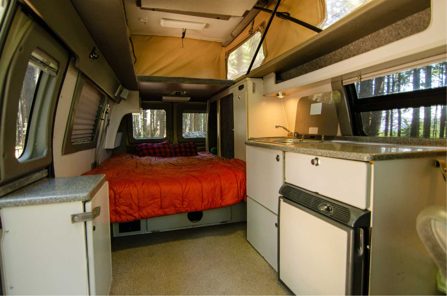 Interior layout of Ford E-Series 4x4 Econoline Sportsmobile EB50 Layout Campervan conversion for sale