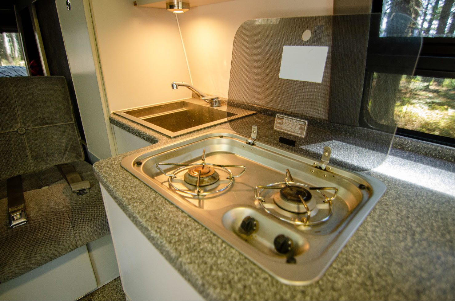 Kitchen of a Ford E-Series 4x4 Econoline Sportsmobile EB50 Layout Campervan conversion for sale