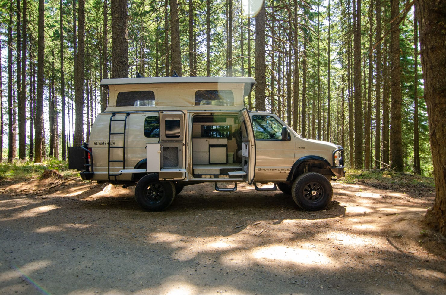 Side view of kitchen galley on a Ford E-Series 4x4 Econoline Sportsmobile EB50 Layout Campervan conversion for sale