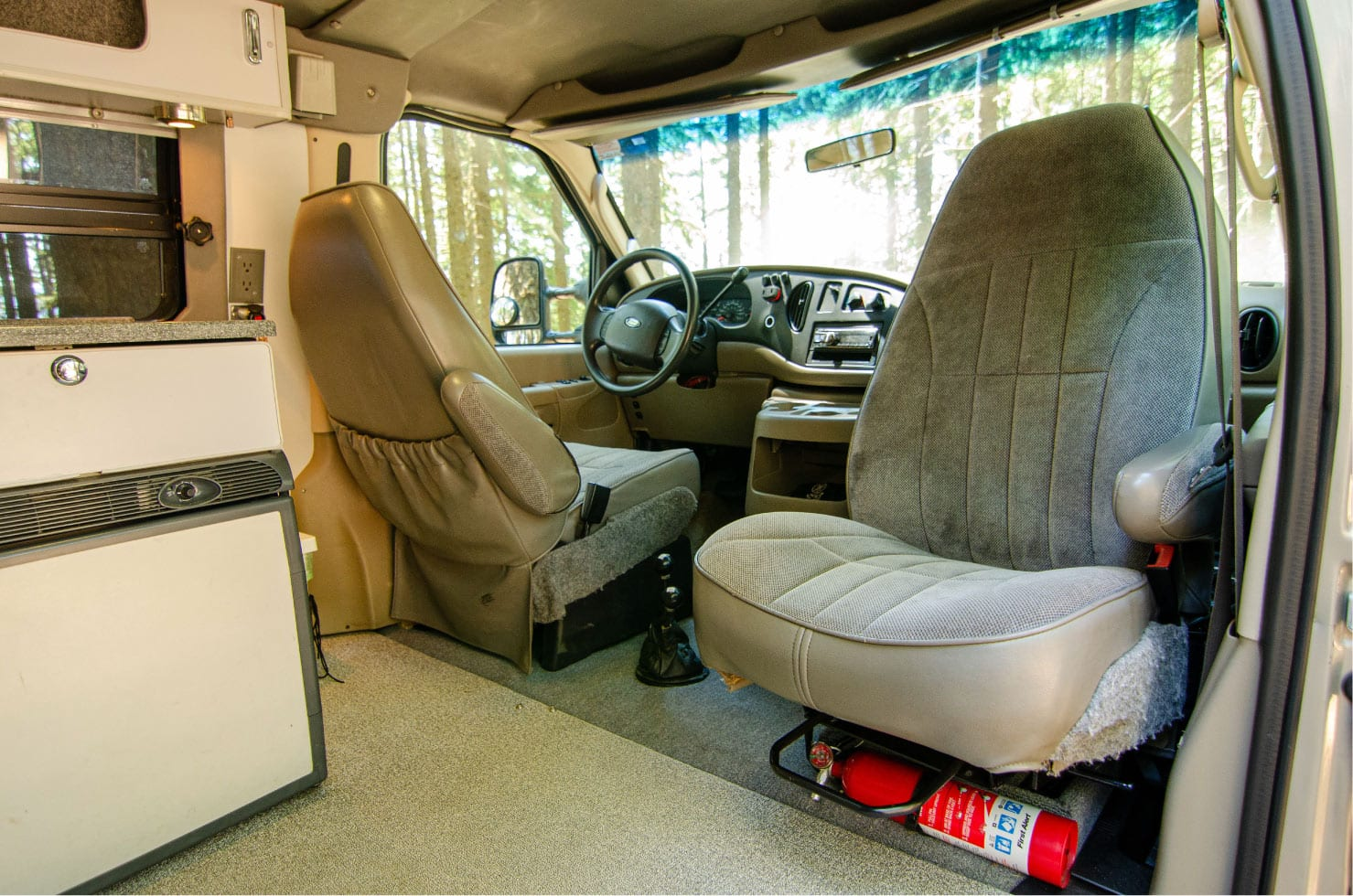 Interior front passenger swivel seat on a Ford E-Series 4x4 Econoline Sportsmobile EB50 Layout Campervan conversion for sale