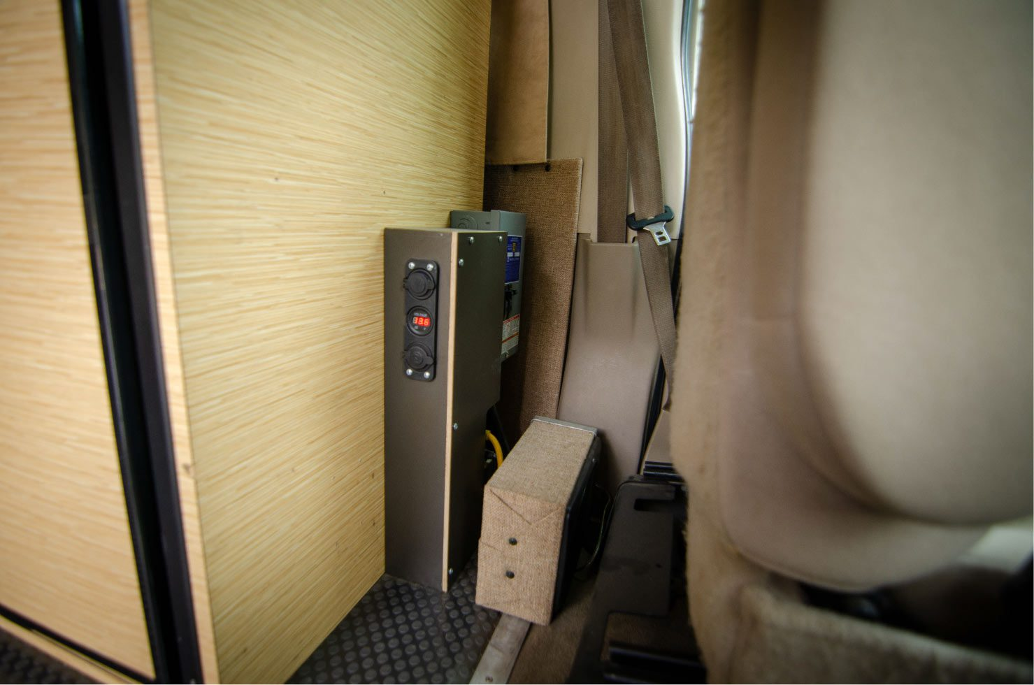 Behind the driver's seat on a Ford E-Series 4x4 Econoline Sportsmobile RB50 Layout Campervan conversion for sale