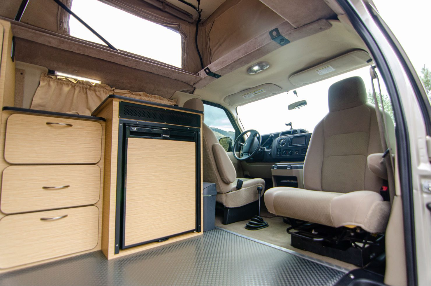 Passenger swivel seat on a Ford E-Series 4x4 Econoline Sportsmobile RB50 Layout Campervan conversion for sale