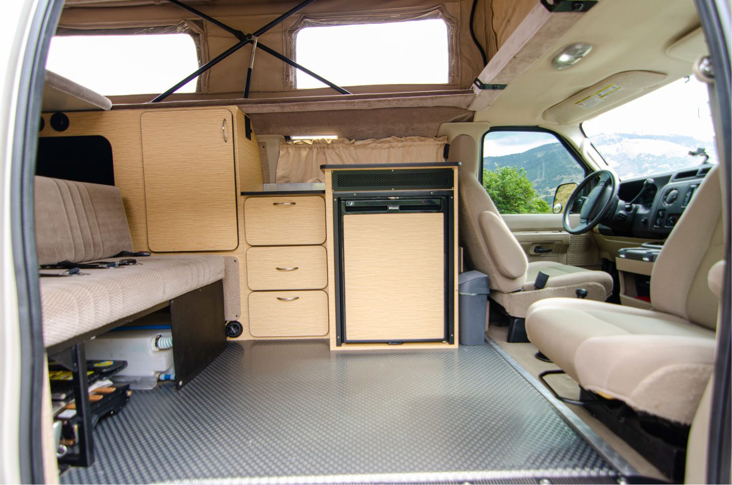 Interior view of a Ford E-Series 4x4 Econoline Sportsmobile RB50 Layout Campervan built by Van Specialties conversion for sale