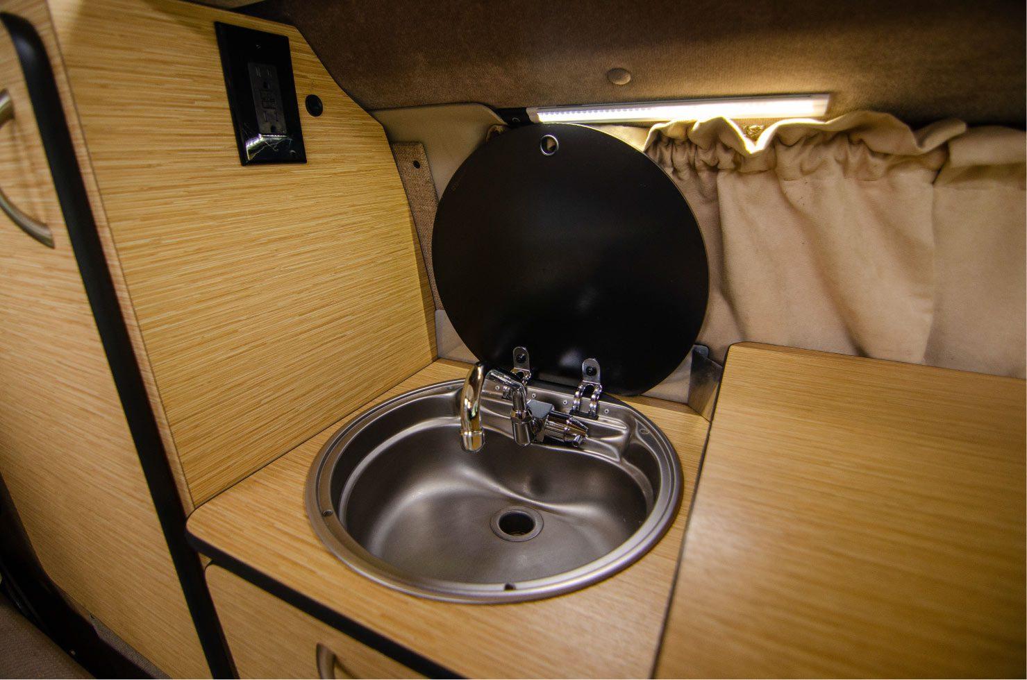 Sink inside a Ford E-Series 4x4 Econoline Sportsmobile RB50 Layout Campervan conversion for sale