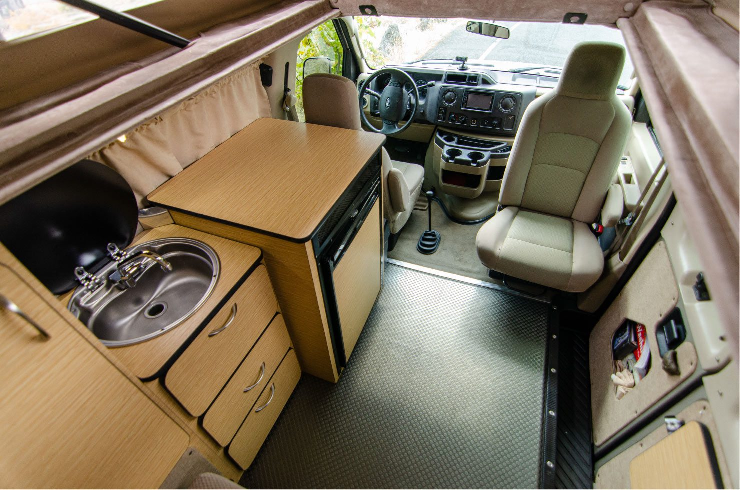 Interior layout of a Ford E-Series 4x4 Econoline Sportsmobile RB50 Layout Campervan conversion for sale built by Van Specialties