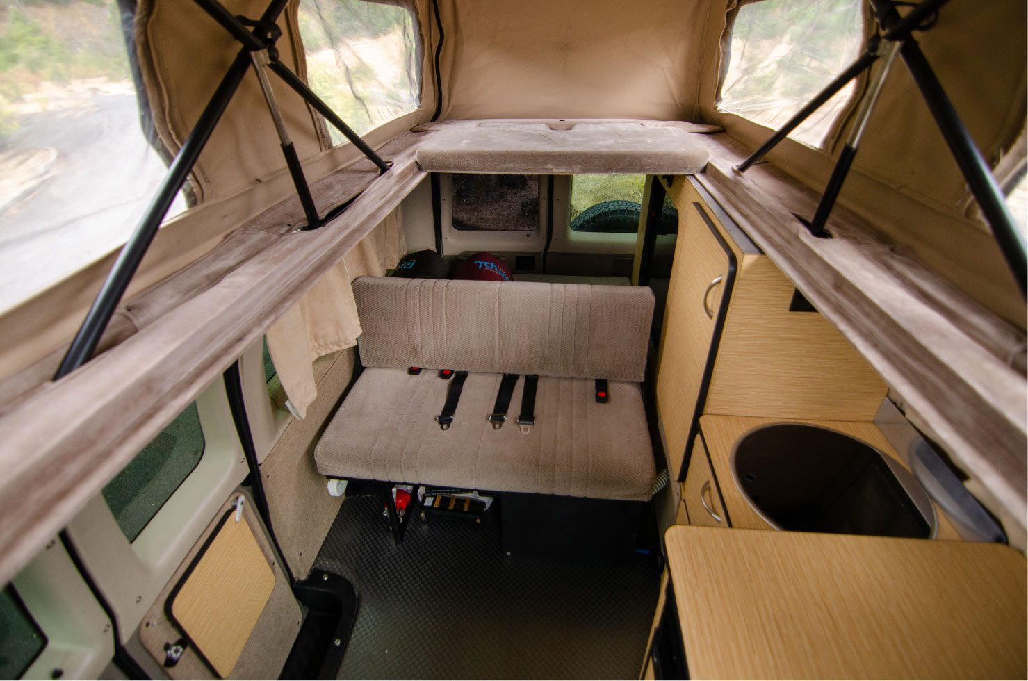 Interior Sportsmobile penthouse and lower bed on a Van Specialties build inside a Ford E-Series 4x4 Econoline Sportsmobile RB50 Layout Campervan conversion for sale
