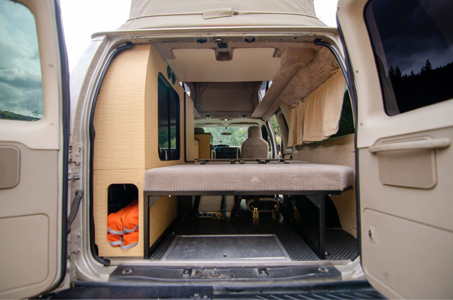 Rear view inside a 4wd Sportsmobile on a Ford E-Series 4x4 Econoline Sportsmobile RB50 Layout Campervan conversion for sale built by Van Specialties