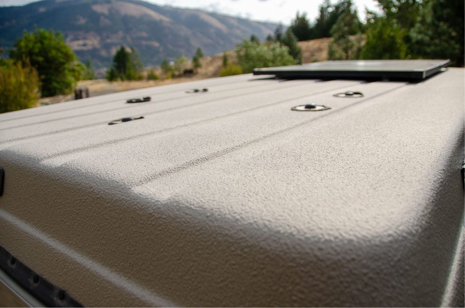 Roof of a 4wd Sportsmobile penthouse with windows that open with screens Ford E-Series 4x4 Econoline Sportsmobile RB50 Layout Campervan conversion for sale built by Van Specialties with Aluminess accessories