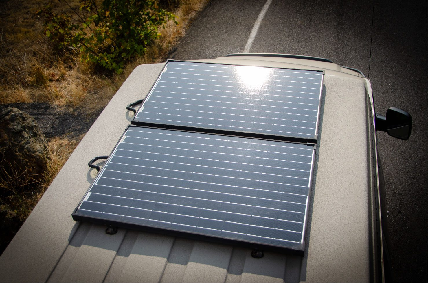Zamp solar panels on top of a Inside view of a 4wd Sportsmobile penthouse with windows that open with screens Ford E-Series 4x4 Econoline Sportsmobile RB50 Layout Campervan conversion for sale built by Van Specialties