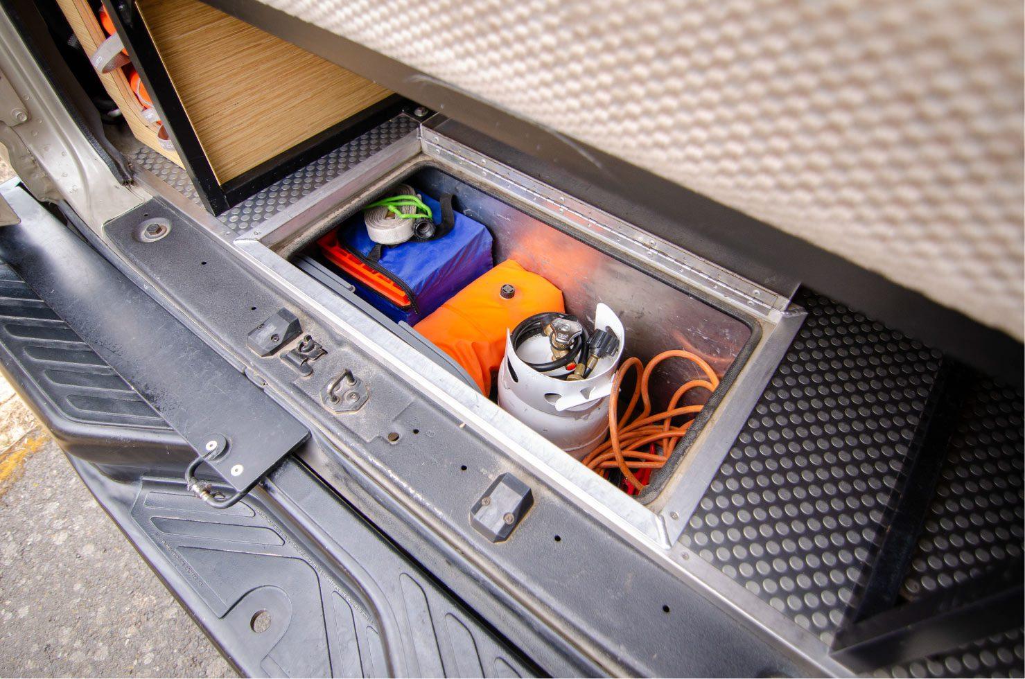 In floor storage of a Van Specialties 2009 4x4 Ford Econoline
